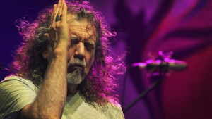 FILE - In this file photo dated Thursday March 21, 2013, Robert Plant, lead vocalist and lyricist of the rock band Led Zeppelin, performs during the Timbre Rock and Roots concert in Singapore. In a statement released from Plant spokesman Ken Weinstein, on Wednesday Nov. 12, 2014, Robert Plant says there is no truth to reports he turned down a lucrative offer from Virgin boss Richard Branson to play Led Zeppelin reunion shows. (AP Photo/Wong Maye-E, FILE)